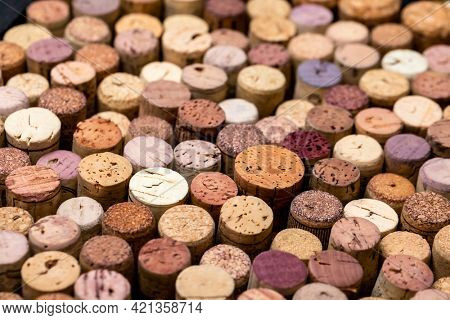 Close-up shot of various used wine corks stack