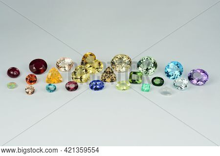 Natural Preciuos, Semi-precious Faceted Polished Gemstones Lot, Horizontal Front Photo On Light Gray