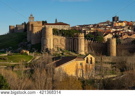 Avila, Spain - December 20, 2020: Walls Of The City Of Avila (world Heritage Site By Unesco) And Cua
