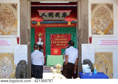 Hoi An, Vietnam, May 23, 2021: Several People Wait Their Turn To Vote In The Trieu Chau Assembly Hal