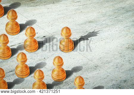Pawn With The Shadow Of The Queen, In Front Of The Pawns. Leadership Concept. Strength And Aspiratio