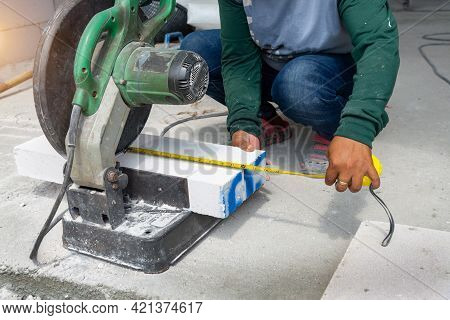 Masonry Contractor Using A Dry Circular Tile Or Rock Cutting Saw To Trim Rock Siding For A Home Inst
