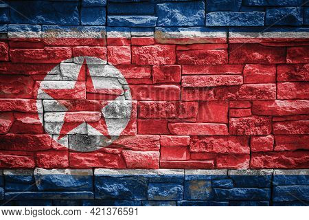 National Flag Of North Korea  On Stone  Wall Background.the Concept Of National Pride And Symbol Of