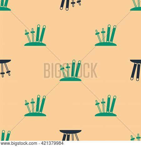 Green And Black Ski And Sticks Icon Isolated Seamless Pattern On Beige Background. Extreme Sport. Sk