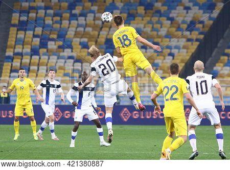 Kyiv, Ukraine - March 28, 2021: Joel Pohjanpalo Of Finland (#20) Fights For A Ball With Yevhen Makar