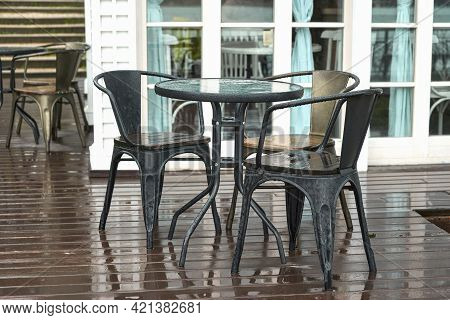 A Table On The Veranda Of A Summer Cafe In The Rain. Selective Focus.