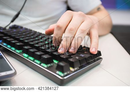 Male Hand On The Keyboard. Keyboard, Modern Technology, Communication. An Illuminated Keyboard.