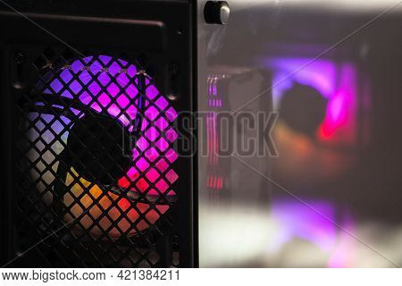 Pink Illumination Of A Cooler Pc System Unit. Computer Fan With Led Illumination. Backlight. Cooler.