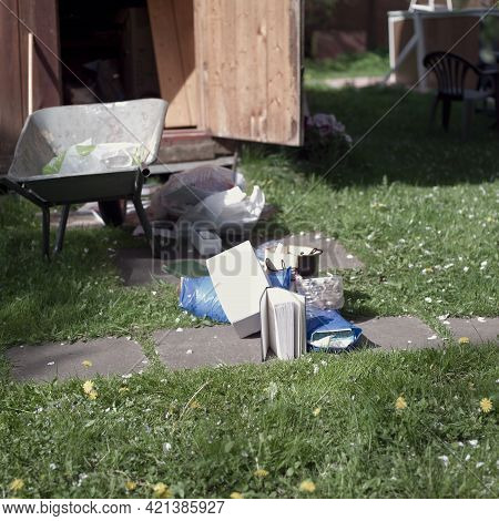 Throwing Various Unwanted Old Stuff Out Of House, Outdoor Shot, Focus In The Foreground