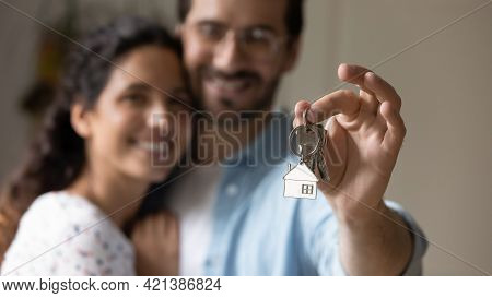 Close Up Focus On Keys In Hands Of Sincere Homeowners.