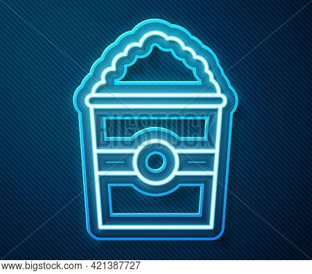 Glowing Neon Line Popcorn In Cardboard Box Icon Isolated On Blue Background. Popcorn Bucket Box. Vec