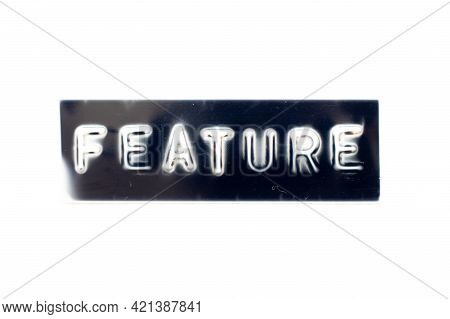 Embossed Letter In Word Feature On Black Banner With White Background