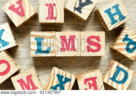 Alphabet Letter Block In Word Lms (abbreviation Of Learning Management System) With Another On Wood