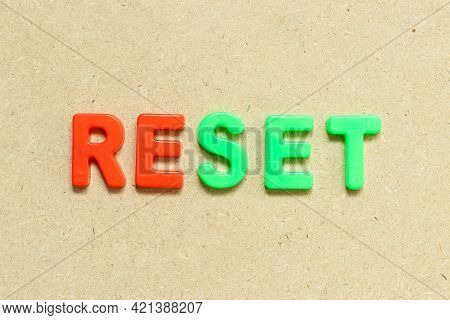 Color Alphabet Letter With Word Reset On Wood Background