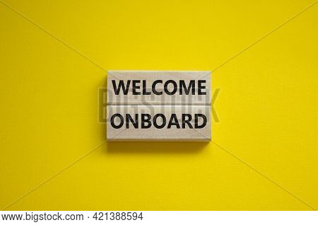 Welcome Onboard Symbol. Wooden Blocks With Words 'welcome Onboard' On Beautiful Yellow Background. B