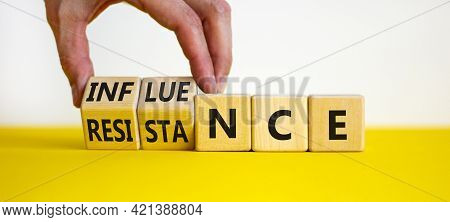 Influence Or Resistance Symbol. Businessman Turns Cubes, Changes The Word 'resistance' To 'influence