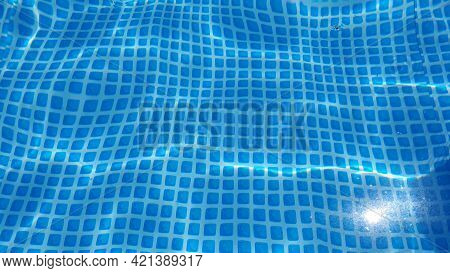 Water Surface Texture With Looping Clean Swimming Pool Ripples And Waves. Refraction Of Sunlight Top