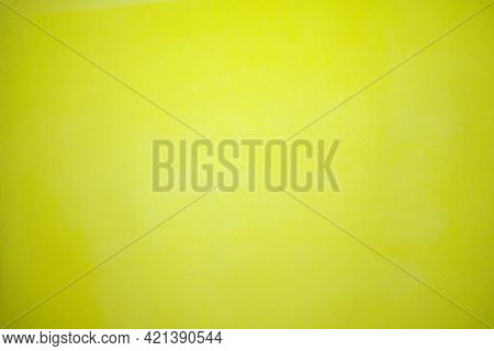 Detail Of Rough Textured Grooved Designer Paper Surface Full Frame Background In Bright Yellow Color