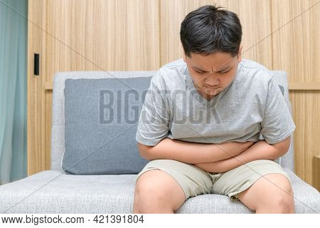 Fat Boy Feeling Stomachache And Sitting On The Sofa, Diarrhea Or Food Poisoning Concept