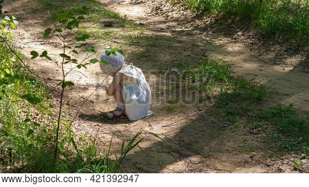 A Lonely Girl In White Clothes Sits On The Road Alone And Cries.