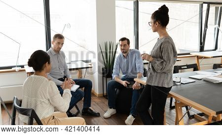 Diverse Employees Team Brainstorming Project Strategy, Involved In Briefing