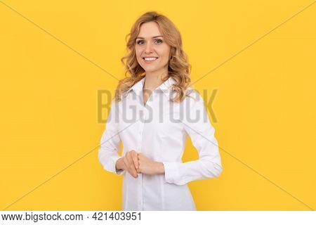 Cheerful Blonde Woman In White Shirt. Office Worker. Corporate Fashion. Business Casual Style.
