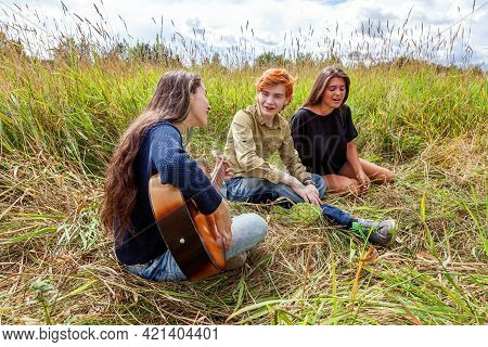 Summer Holidays Vacation Music Happy People Concept. Group Of Three Friends Boy And Two Girls With G
