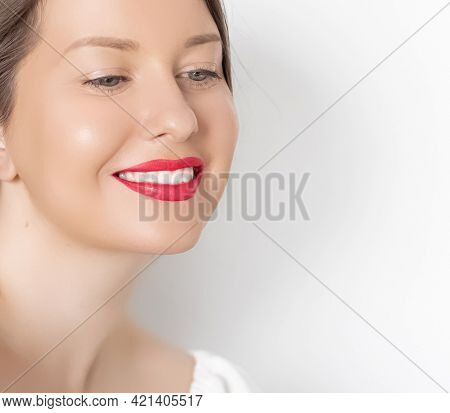 Happy Smiling Young Woman With Perfect White Teeth And Beautiful Healthy Smile, Clean Skin And Natur