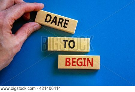 Dare To Begin Symbol. Wooden Blocks With Words 'dare To Begin'. Beautiful Blue Background, Businessm