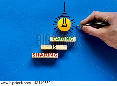 Sharing Is Caring Symbol. Concept Words 'sharing Is Caring' On Wooden Blocks On A Beautiful Blue Bac