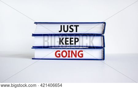 Just Keep Going Symbol. Books With Words 'just Keep Going'. Beautiful White Background. Business, Ju