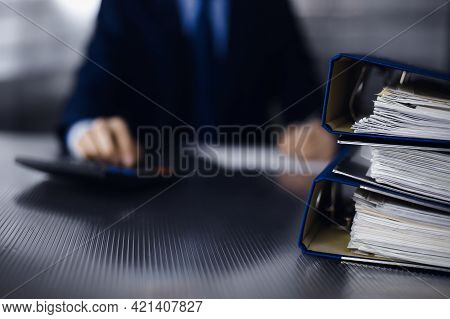 Binders With Papers Are Waiting To Be Processed By Man Accountant In Blue Blazer Staying At Home Dur