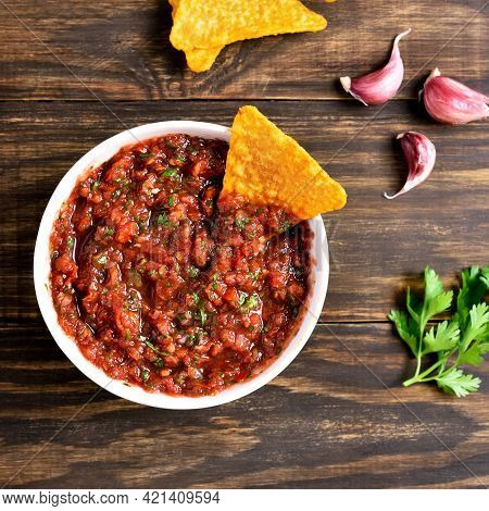 Tomato Salsa In Bowl Over Wooden Background. Top View, Flat Lay