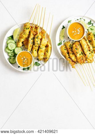 Chicken Satay With Peanut Sauce. Grilled Chicken Skewers Served With Peanut Dipping Sauce. White Bac