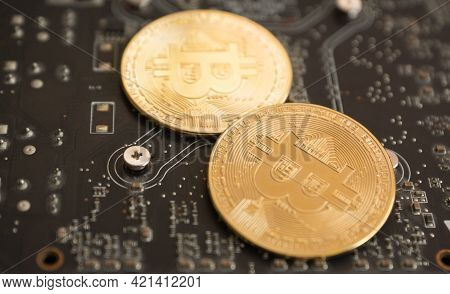 Close-up Bitcoin On Computer Motherboard Cryptocurrency Mining Theme. Computer System And Bitcoin Co