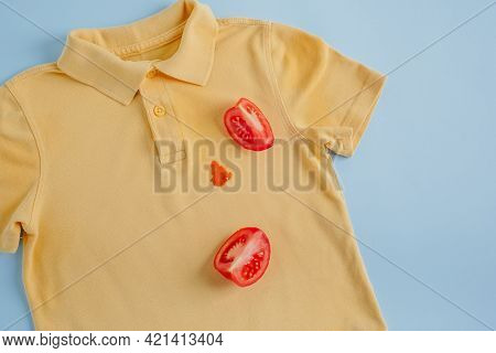 Dirty Stain Of Tomato On A Yellow Polo. Top View