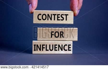 Contest For Influence Symbol. Wooden Blocks With Words 'contest For Influence'. Beautiful Grey Backg