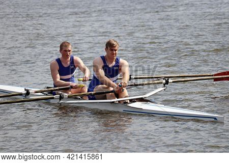 Moscow, Russia - May 2021: Two Guys Are Rowing In A Boat. Athletes During The Competitions On The Ro