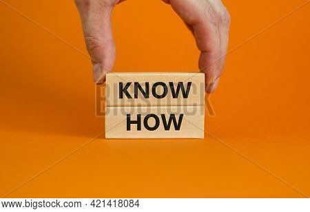 Know How Symbol. Wooden Blocks With Words 'know How' On Beautiful Orange Background, Copy Space. Bus