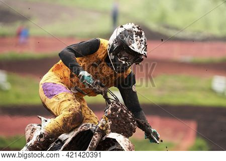 Motorcycle Racing In The Rain. A Fragment Of A Motorcycle Racer In The Mud, Moving At High Speed. Se