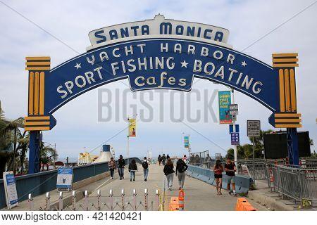 May 14, 2021 Santa Monica California, USA: Santa Monica Pier Entrance Sign with tourist taking Location Shot Photos. Tourist from around the world enjoy taking Location Shot photos. Editorial Use.