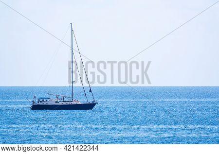Sailing Yacht In The Blue Calm Sea.
