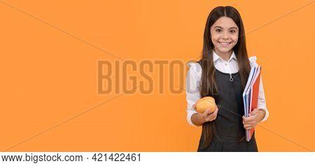 Individual Study. Happy Schoolgirl Hold Apple And Books. Self Study. Homework. School Education