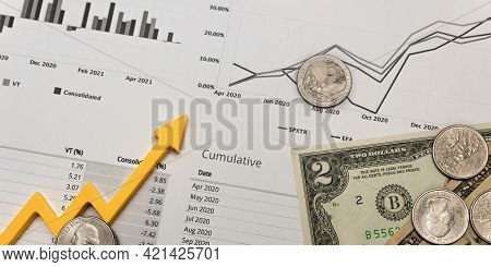 Investment Report, Financial Quarterly Report, Money On A Printed Sheet Of A Quarterly Report And Gr