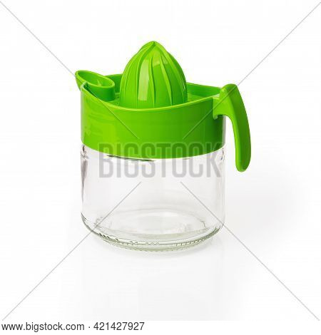 Green Manual Citrus Juicer With Glass Jar Container Isolated On White Background. Modern Citrus Pres