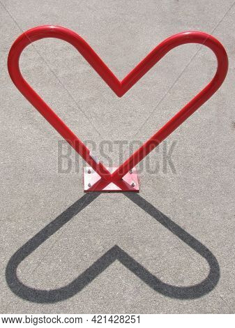 Red Heart-shaped Bike Rack And Its Shadow