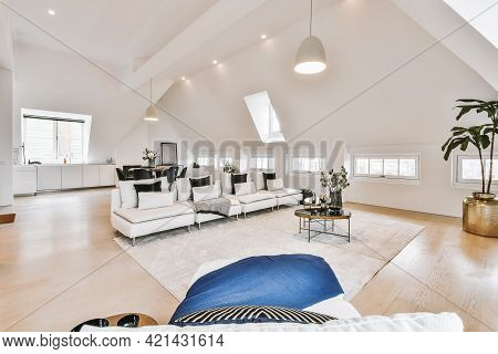 Contemporary Minimalist Interior Design Of Lounge Zone With Couches And Carpet In Attic Open Space A