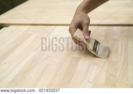 Applying Protective Painting Varnish By Hand On A Wooden Texture, Diy And Repair House Equipment Con