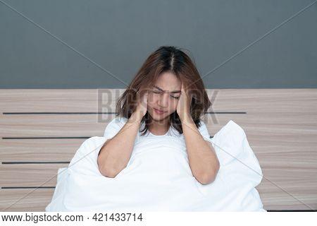 Young Asian Women Having A Strong Headache