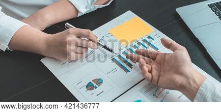 Brainstorm team, Marketers and financial accountants are discussing and analyzing charts to plan str